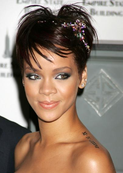 rihanna tattoo shoulder. around my shoulder/chest?